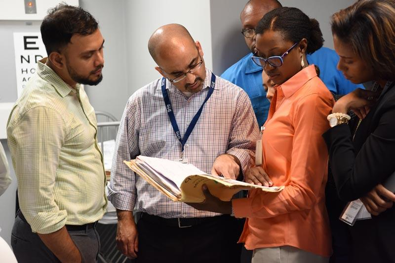 Orbis Volunteer Faculty member Dr. Malik Kahook instructs ophthalmologists the glaucoma center at Queen Elizabeth Hospital, Photography: Geoff Bugbee, 2018.