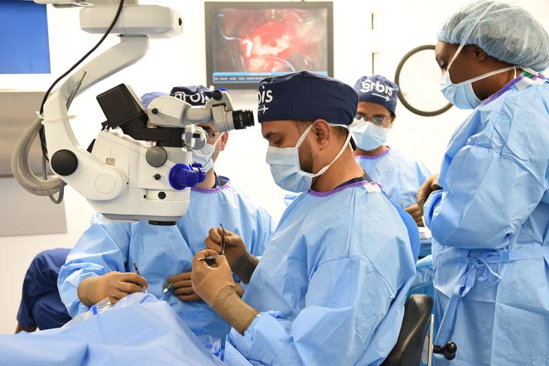 Dr. Shailendra Sugrim, a Guyanese Consultant Ophthalmologist, participates in Orbis's Flying Eye Hospital training in Barbados, Photography: Geoff Bugbee, 2018.