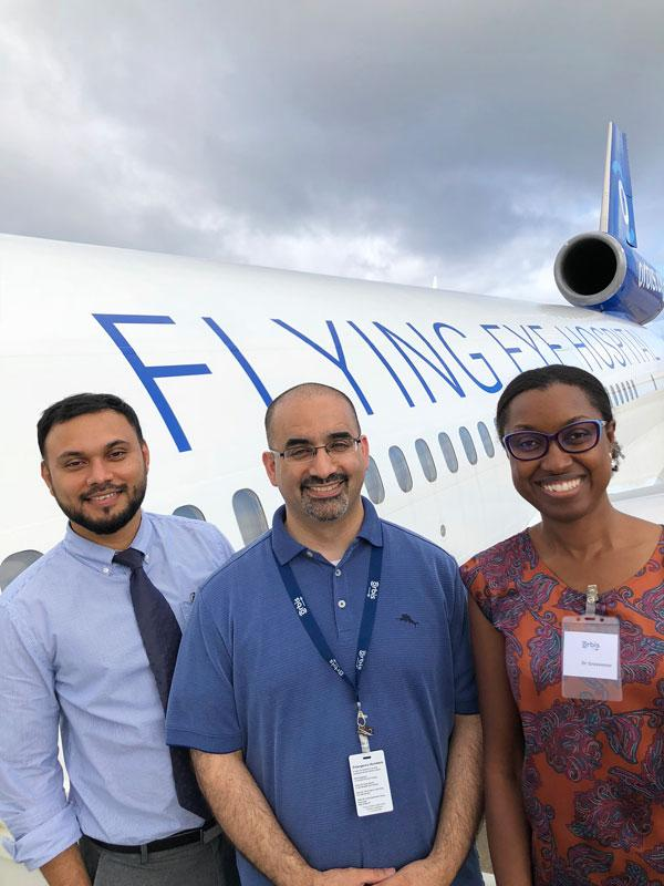 Dr. Shailendra Sugrim, Volunteer Faculty Dr. Malik Kahook, and Dr. Dawn Grosvenor, outside Flying Eye Hospital, Photography: Geoff Bugbee, 2018.