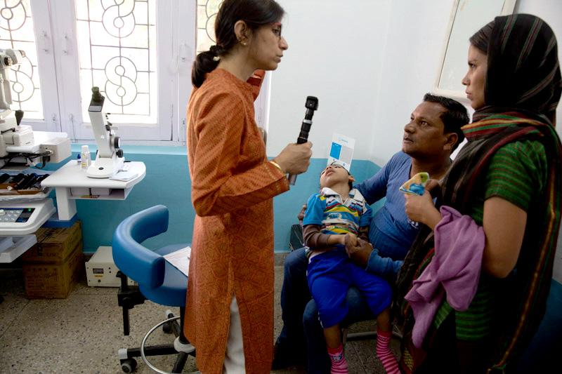 A child with cerebral palsy being evaluated.